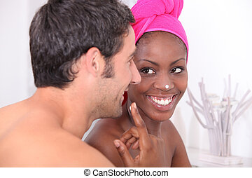 Playful couple in bathroom