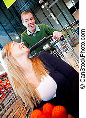 Playful Couple in Supermarket