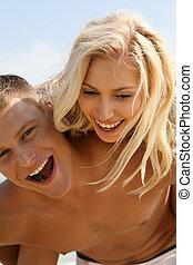 Playful couple on the beach