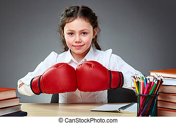 Playful cute little girl having fun in boxing gloves while ...