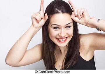 Playful cute woman having fun