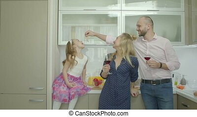 Playful family enjoying leisure in domestic kitchen -...