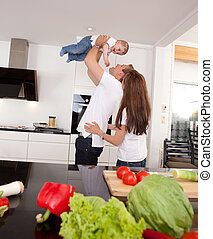 Playful Family in Kitchen - Happy playful family in kitchen...