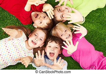Playful friends - Image of smiling young boys and girls...