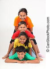 Playful friends in totem-pole - Playful school friends...