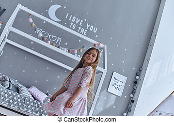 Playful girl. Lovely little girl smiling and looking at...