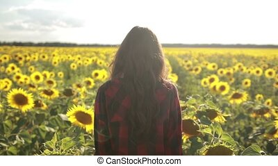 Playful girl relaxing in sunflower field - Playful female...