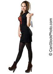 Playful girl with a little handbag in black dress