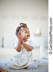 Playful infant - Portrait of a cute little girl having fun