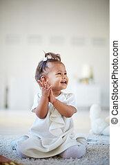 Portrait of a cute little girl having fun