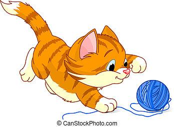 Playful Kitten - Kitten playing with yarn ball