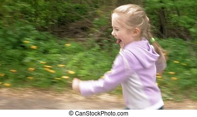 Playful little girl runs on game laughs and smiles
