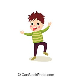 Playful little kid jumping with hands up and making face and showing his tongue