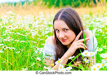playful look girls in camomile field