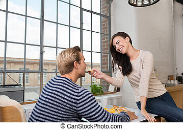 Playful loving couple in the kitchen