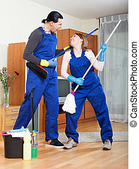 Playful man and woman cleaning