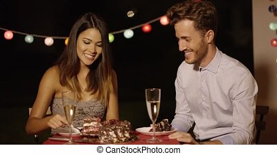 Playful man looking with anticipation at cake - Playful...