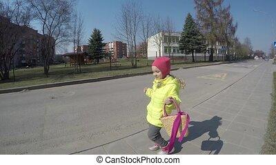 playful model girl pose with handbag. Cute toddler child...
