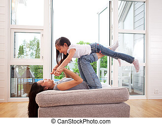 Playful Mother and Daughter - Playful mother giving daughter...