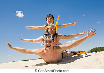 Playful people - Portrait of cheerful couple and their son...