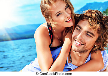 playful - Portrait of a happy couple enjoying vacation on ...