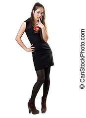 Playful pretty girl in black dress. Isolated