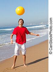 playful teen boy - a playful teenage boy on the beach ...