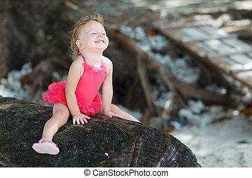 Playful toddler girl in swimsuit