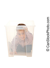 Playful toddler in a box
