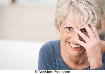 Playful vivacious elderly woman