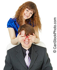 Playful woman covered eyes of man