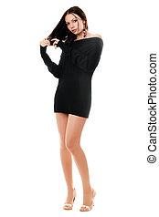 Playful woman in black dress