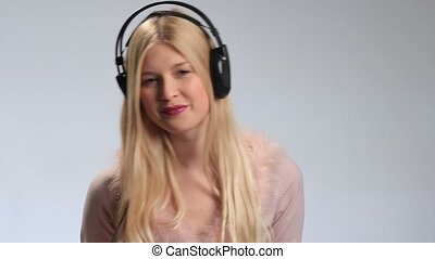 Playful woman with headphones listening to music