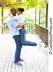 playful young african couple