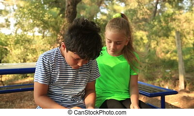 Playful young boy and girl - Brother and sister start a...