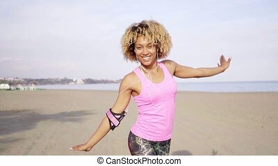 Playful young carefree fit adult at beach