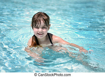 Playful Young Child in the Pool - Cute Young Child Swimming...
