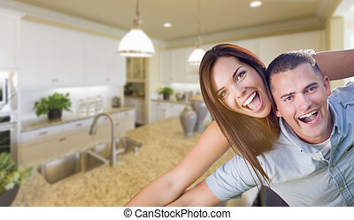 Playful Young Military Couple Inside Beautiful Custom Kitchen