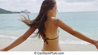 Playful Young Woman In Bikini Enjoying Summer Vacation At Waikiki Beach