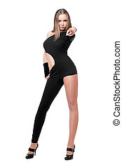 Playful young woman in skintight black costume
