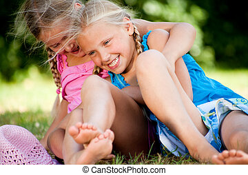 Playfull twins - Two little girls in fresh colors in the...