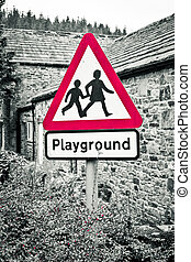 Playground - A playground warning sign with selective color...