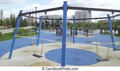 Playground closed with quarantine tapes in the city park of Southern Butovo