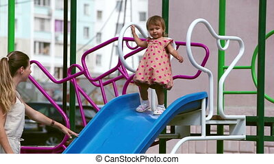 Playground fun - Mother and daughter having fun on the...