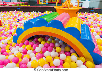Playground indoor with colourful balls and in the kid's zone
