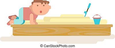 little boy in sand-box