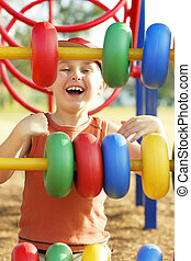 Playground laughs - Laughing child spinning colourful loops...