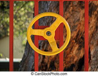 Playground equipment - Yellow steering wheel on red bars