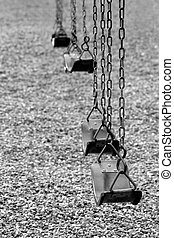 playground swings in black and white