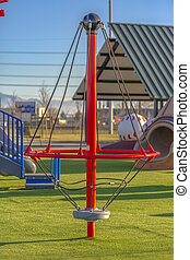 Playground toy with ropes and center pivot